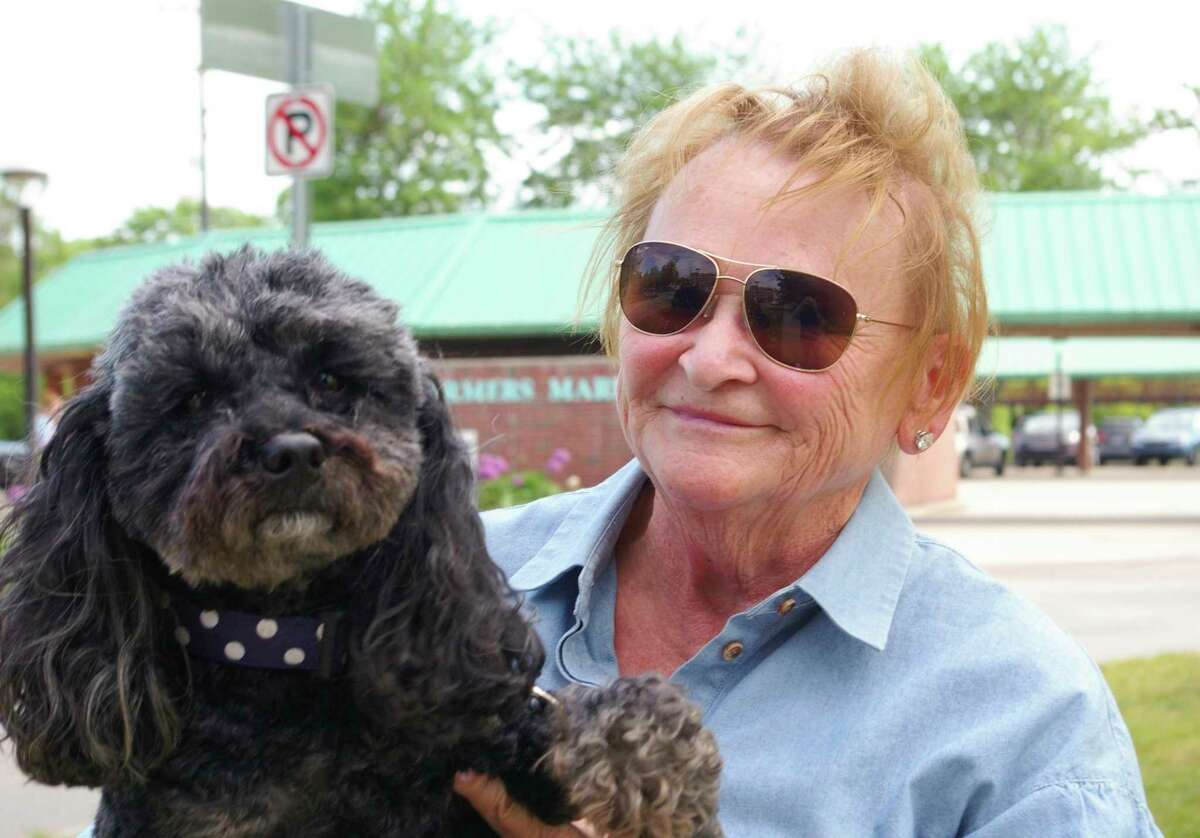 Sharon Sny and Phoebe, her Toy Goldendoodle, moved to Midland last year. Friday night, they enjoyed a walk near the Tridge. (Photo by Niky House)