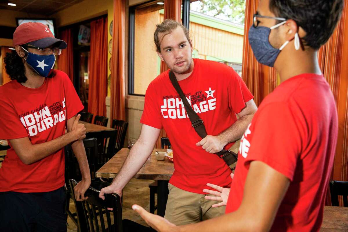 Volunteers Azfar Budhwani, left, and Drake Johnson, center, await election results at the watch party for incumbent candidate John Courage at Tilo Mexican restaurant on Saturday, June 5, 2021 in San Antonio.