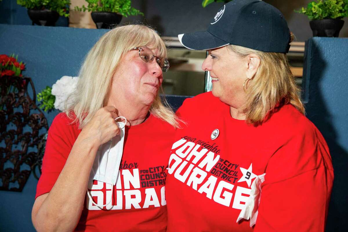 Zada True Courage, left, wife of District 9 City Councilman John Courage, gets emotional as she celebrates early results alongside Jamie Eickhoff during the election results party her her husband at Tilo Mexican restaurant on Saturday, June 5, 2021 in San Antonio.