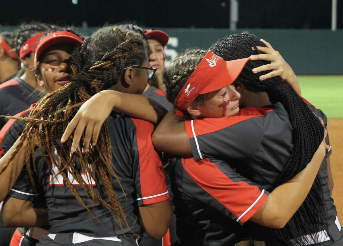 Judson Rockets players console each other following a 1-0 loss to Deer Park in the Class 6A state softball championship game on Saturday, June 4, 2021 in Austin, Texas.