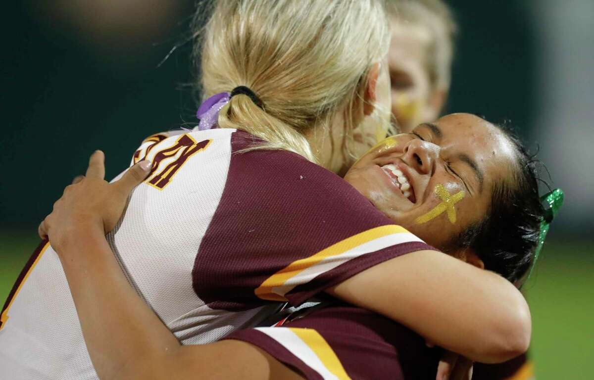 Deer Park starting pitcher Hannah Benavides (7) is embraced by first baseman Haley Wilkerson (11) after being namd MVP after defeating Judson 1-0 to win Class 6A UIL state championship at Red & Charline McCombs Field, Saturday, June 5, 2021, in Austin.
