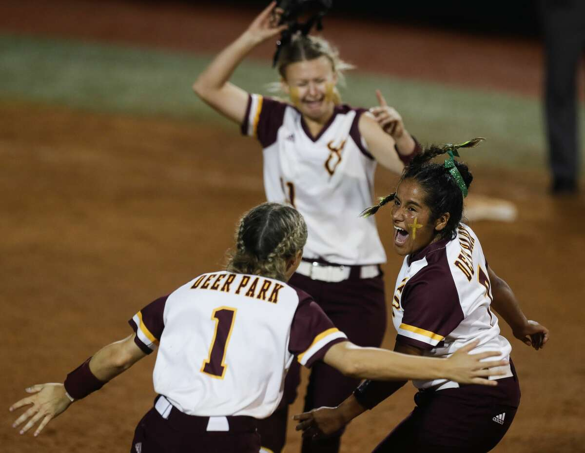 Deer Park starting pitcher Hannah Benavides (7) reacts with third baseman Haidyn Hardcastle (1) and first baseman Haley Wilkerson (11) after defeating Judson 1-0 to win Class 6A UIL state championship at Red & Charline McCombs Field, Saturday, June 5, 2021, in Austin.