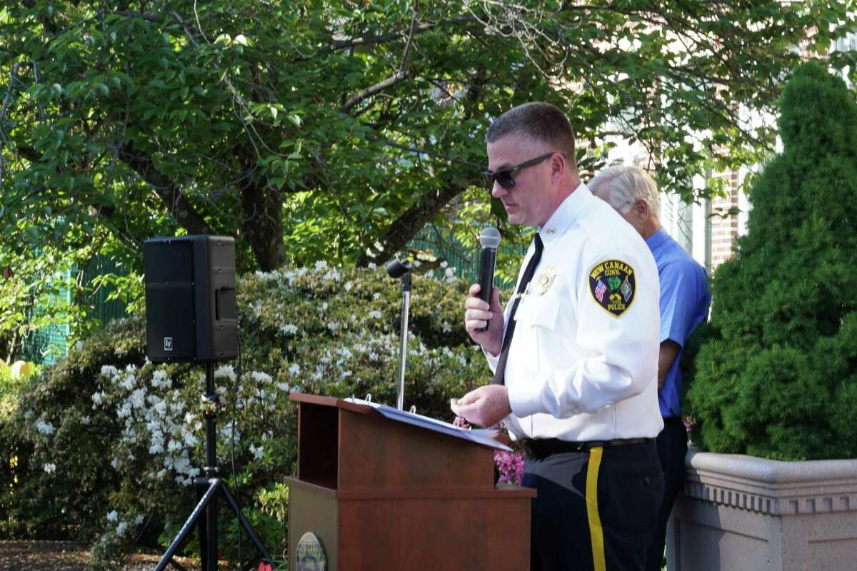 Police Chief Leon Krolikowski presented several awards to officers at an outdoor ceremony.