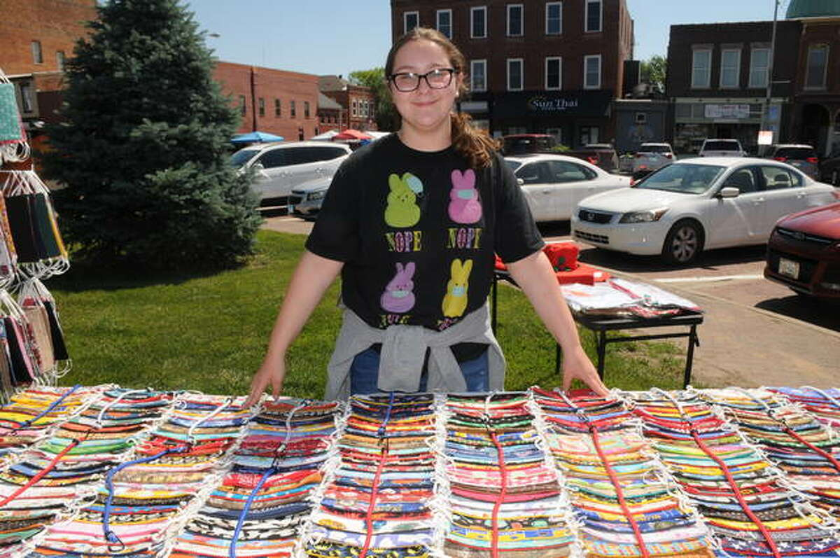 Maris Brill, 13, of Gillespie sold hand-sewn masks during Saturday's Carlinville Market Days.