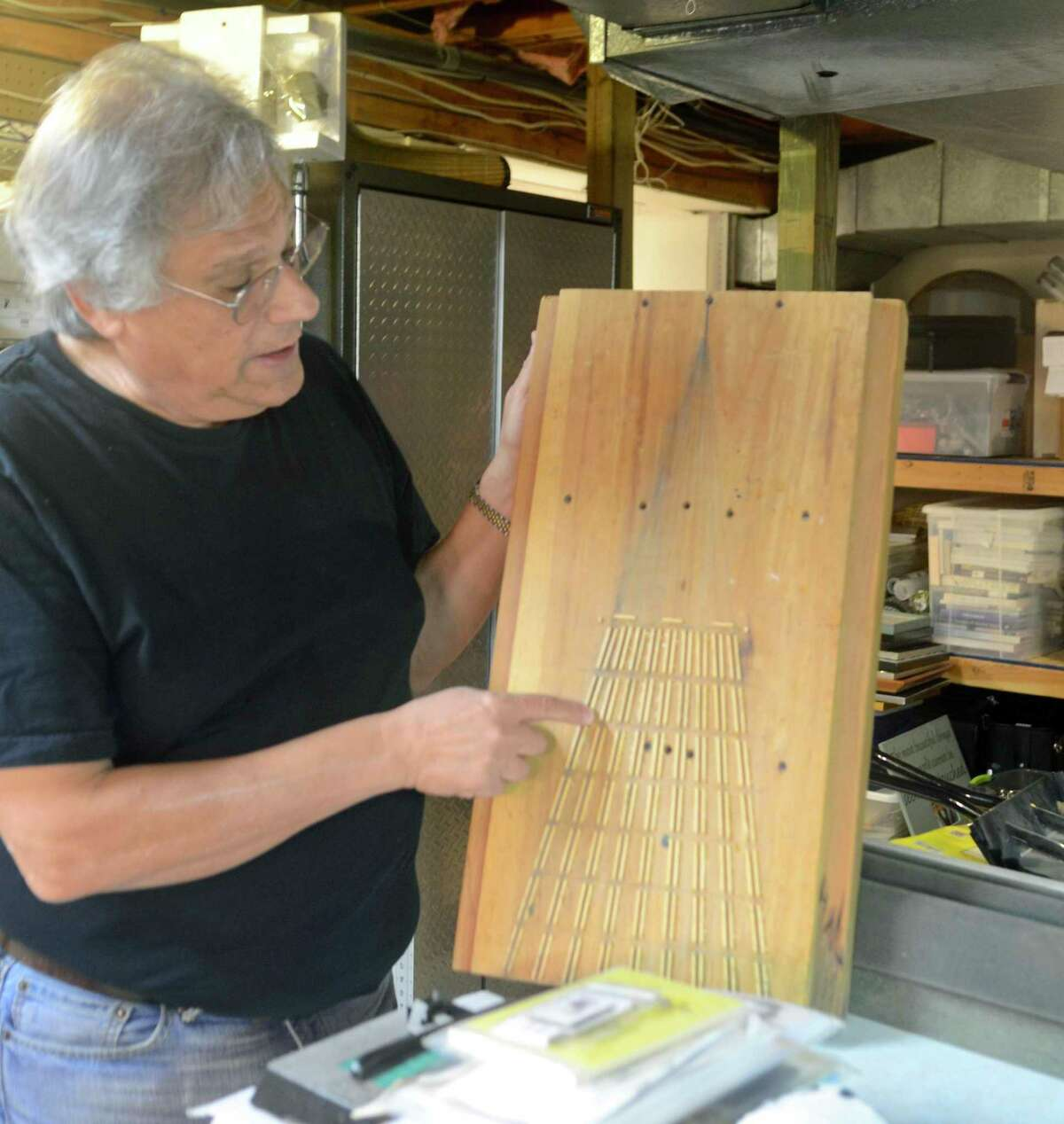 Friedler has to make the pieces or templates so he can build some of the tiny elements that go into building trestles and bridges.