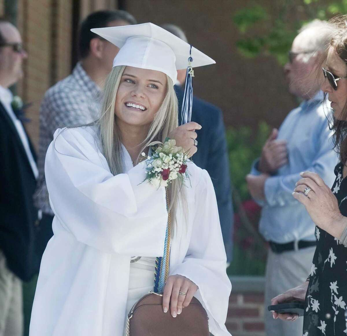 Emma Halas awaits the graduation ceremony of Immaculate High School to begin at St. Rose of Lima Church in Newtown on Saturday.