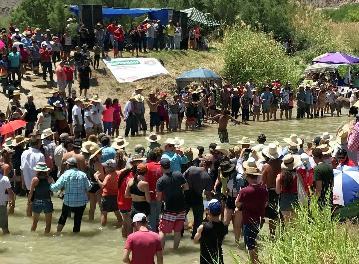 Along the border near Lajitas each spring, Texans and Mexicans wade the river to greet friends and relatives.
