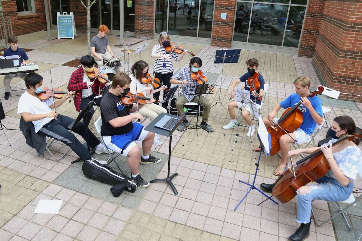 The Pop Strings group from Darien High School performs at the Darien library during the recent academic school year. on Wednesday, June 2, 2021. The library has announced a new Digital Library that is called ComicsPlus, which consists of comic books, graphic novels, and the art form manga.