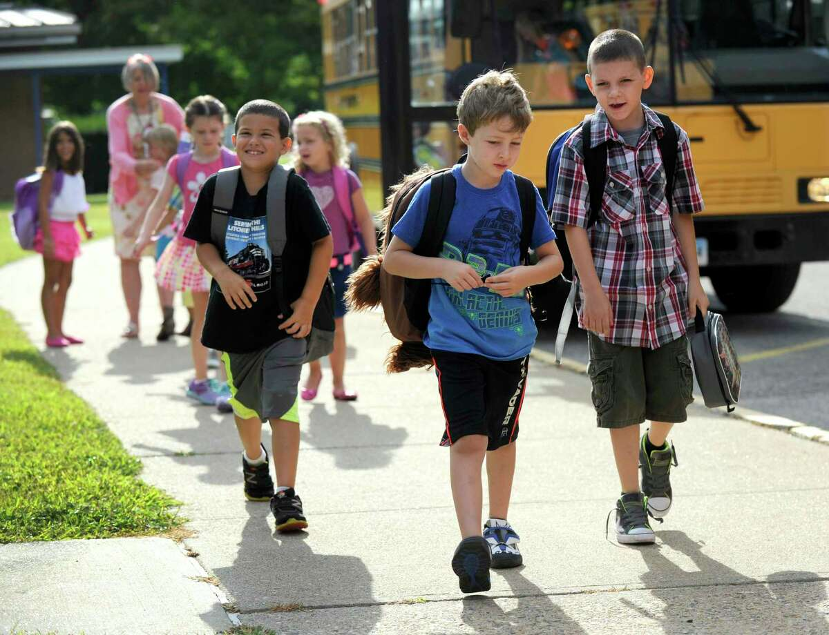 New Milford children returned to school after summer vacation Monday, August 24, 2015. Photos taken at Hill and Plain School in New Milford.