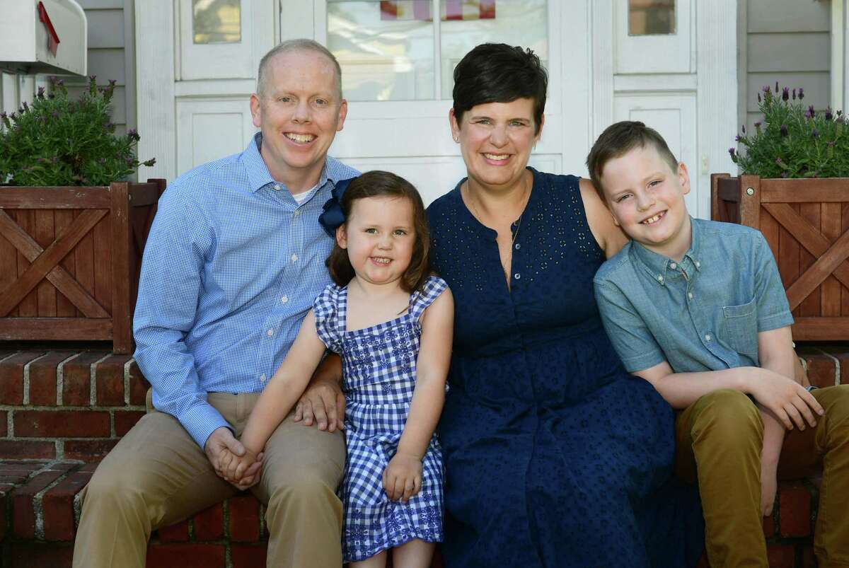 Jenn McMurrer, second from right, and her family, husband Ryan McMurrer and children, Madeline and Harrison, at her home, Saturday, June 5, 2021, in Norwalk, Conn. McMurrer is running for Common Council for this election year. She is looking to take one of the two district C seats