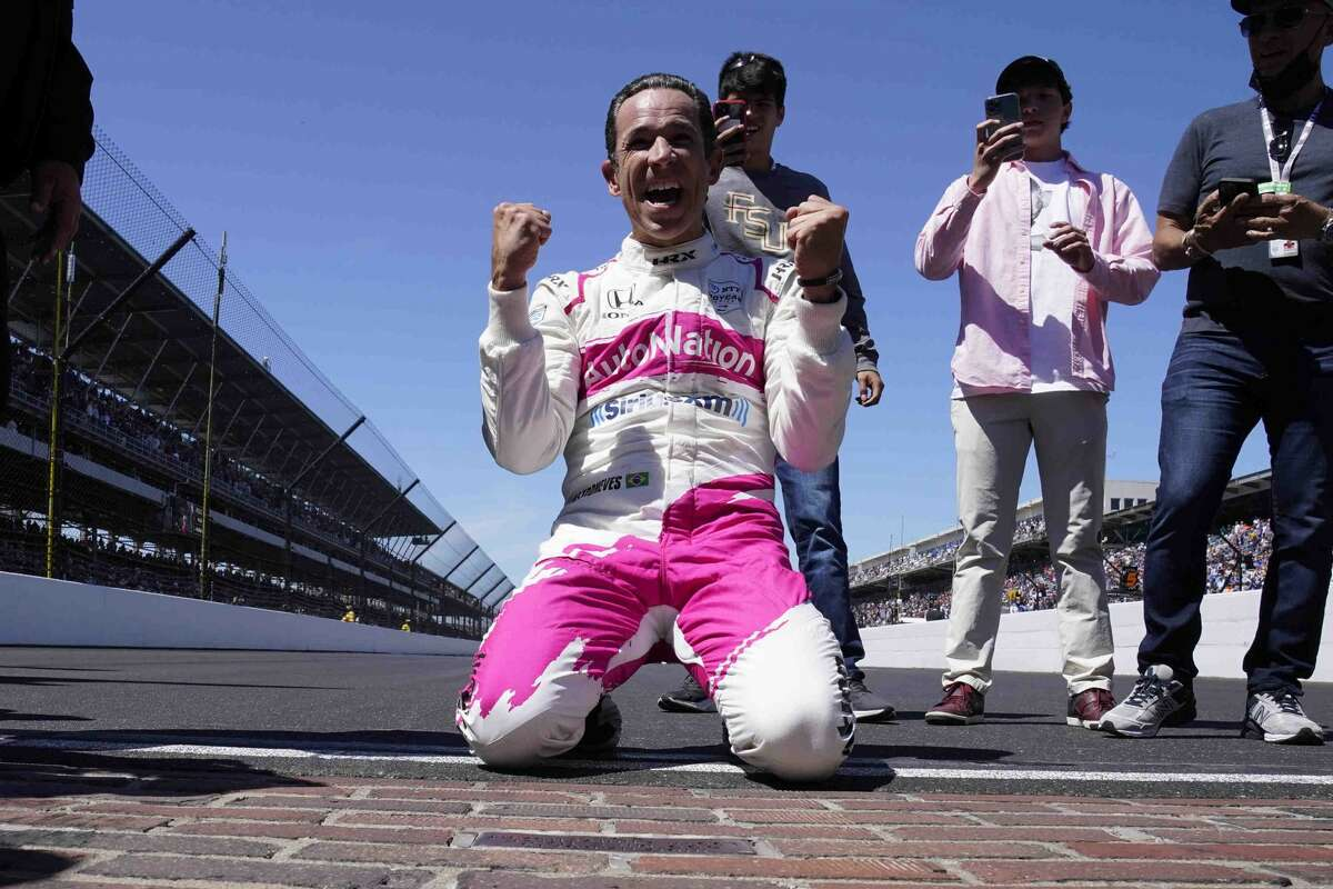 Helio Castroneves celebrates his fourth victory after the Indianapolis 500 auto race at Indianapolis Motor Speedway in Indianapolis, Sunday, May 30, 2021. (AP Photo/Paul Sancya)