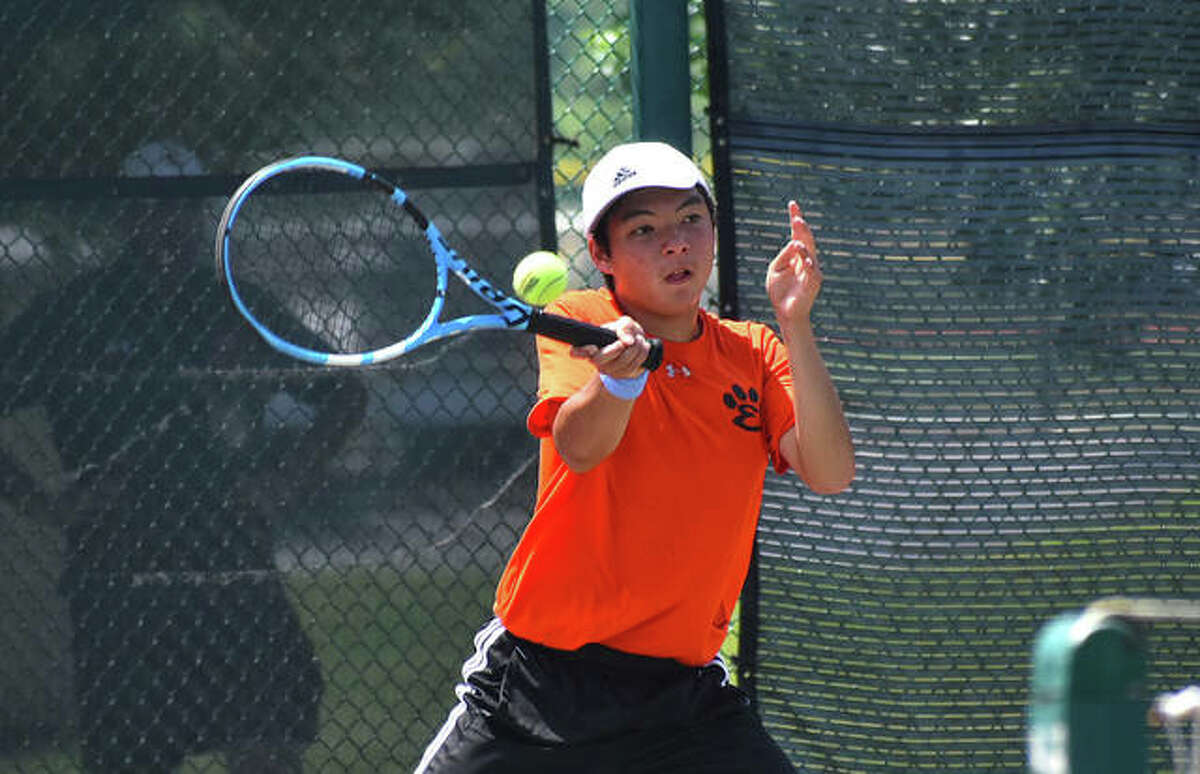 Edwardsville's Jade Dynamic hits a forehand shot during his doubles match in the Class 2A Belleville West Sectional final on Saturday in Belleville.
