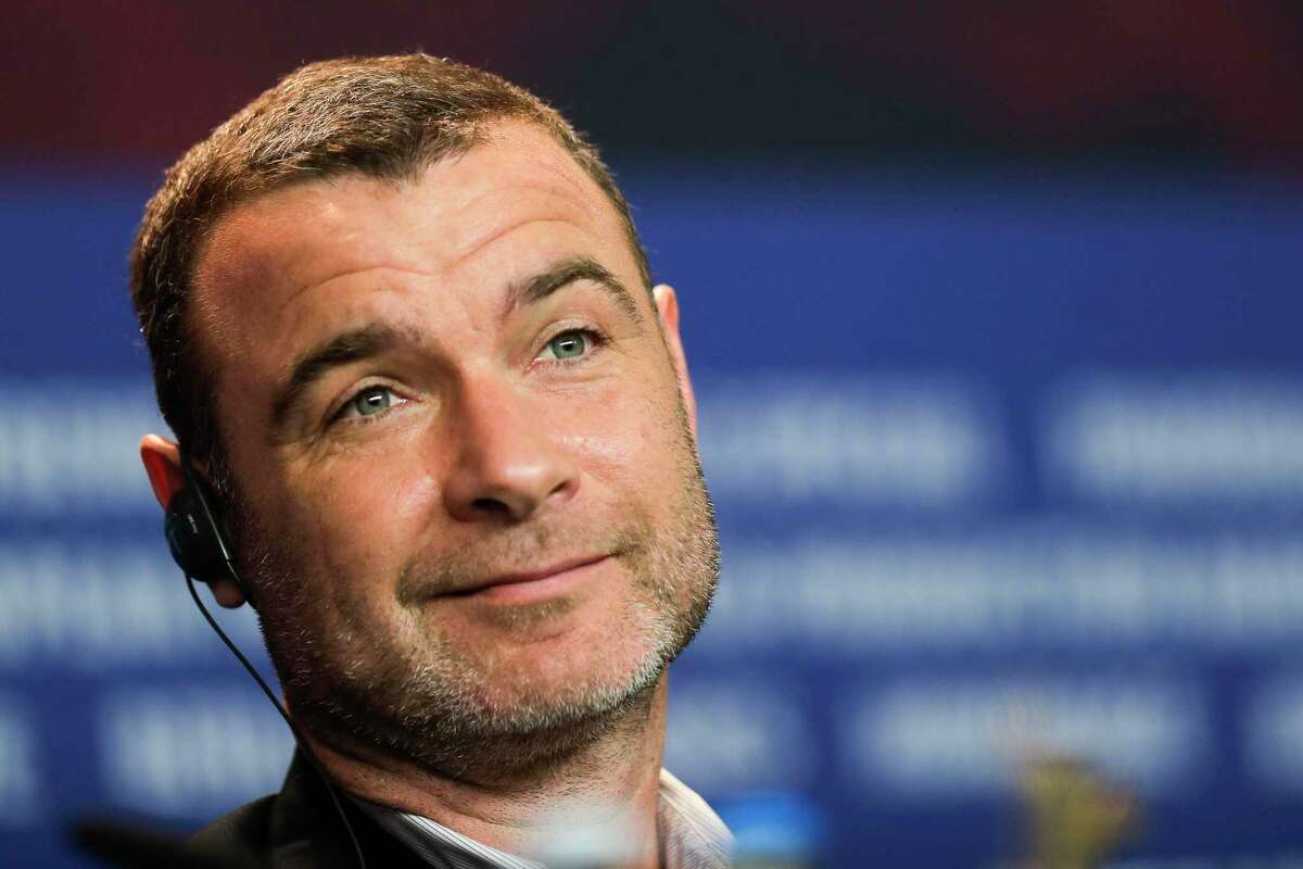 """FILE - In this Feb. 15, 2018, file photo, Liev Schreiber attends a news conference for the movie """"Isle of Dogs"""" in Berlin, Germany. Schreiber on Tuesday, Aug. 14, 2018, denied allegations that he attacked a local photographer while he was in suburban New York filming the popular Showtime series """"Ray Donovan."""" (AP Photo/Markus Schreiber, File)"""