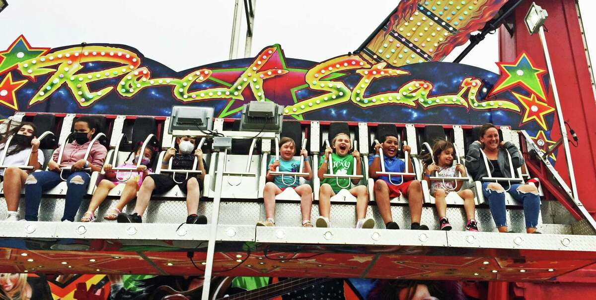 Riders on Rock Star at the Powers Great American Midway carnival at the Danbury Fair mall in June 2021.