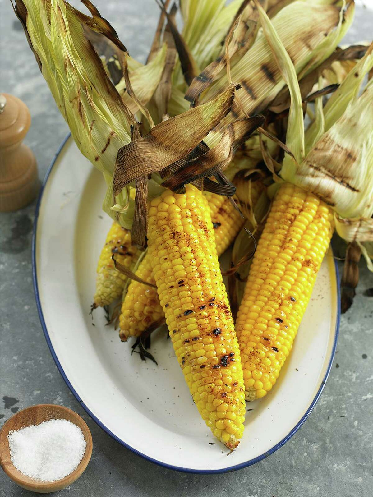 For the best flavor, grill whole ears of sweet corn with the husks on for about 20 minutes over medium heat.