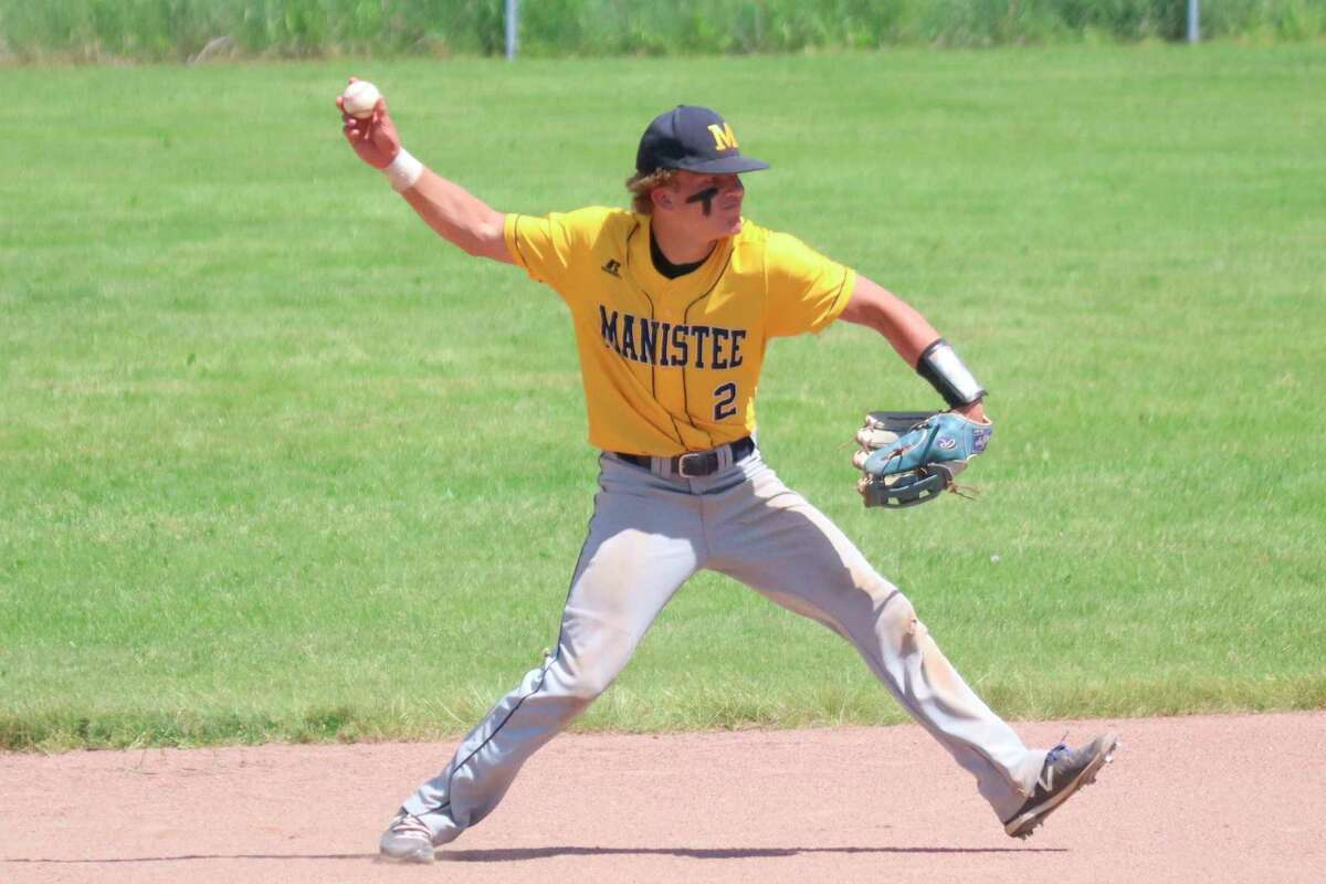 Manistee shortstop Adam Workman throws for the out at first during Saturday's district championship game against Benzie Central. (Robert Myers/News Advocate)