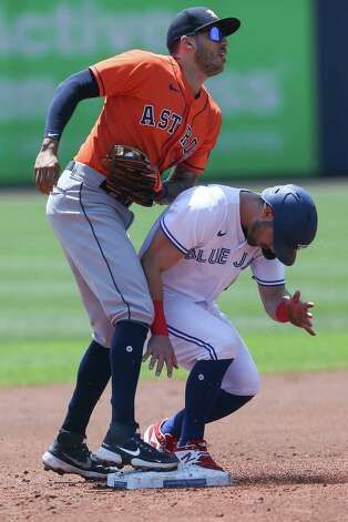 Toronto Blue Jays' Randal Grichuk, right, collides with Houston Astros shortstop Carlos Correa, left, breaking up a potential double play opportunity during the second inning of a baseball game in Buffalo, N.Y., Sunday, June 6, 2021. (AP Photo/Joshua Bessex) Photo: Joshua Bessex, Associated Press / Copyright 2021 The Associated Press. All rights reserved