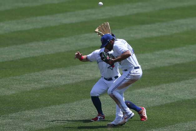 Toronto Blue Jays shortstop Marcus Semien (10) nearly collides with center fielder Randal Grichuk, left, as Grichuk makes a catch to get out Houston Astros' Alex Bregman during the fourth inning of a baseball game in Buffalo, N.Y., Sunday, June 6, 2021. (AP Photo/Joshua Bessex) Photo: Joshua Bessex, Associated Press / Copyright 2021 The Associated Press. All rights reserved
