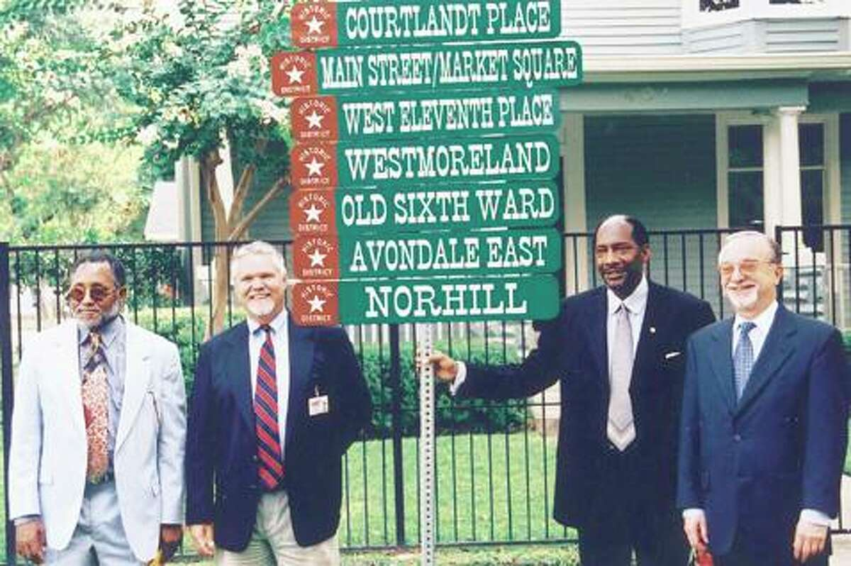 In this file photo from 2000, organizers pose in front of signs for some of Houston's historically designated neighborhoods.