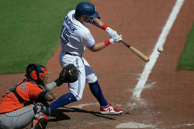 Toronto Blue Jays' Randal Grichuk (15) hits a single to score Bo Bichette during the eighth inning of a baseball game against the Houston Astros in Buffalo, N.Y., Sunday, June 6, 2021. (AP Photo/Joshua Bessex) Photo: Joshua Bessex, Associated Press / Copyright 2021 The Associated Press. All rights reserved
