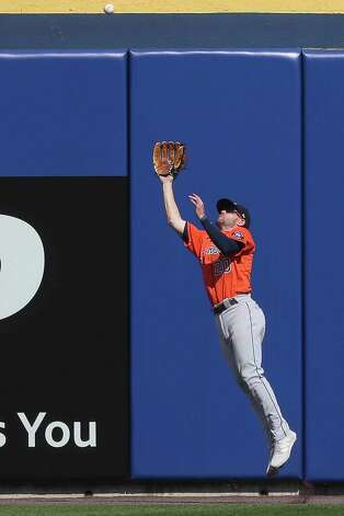 Houston Astros left fielder Chas McCormick makes a leaping catch to get out Toronto Blue Jays' Rowdy Tellez during the ninth inning of a baseball game in Buffalo, N.Y., Sunday, June 6, 2021. (AP Photo/Joshua Bessex) Photo: Joshua Bessex, Associated Press / Copyright 2021 The Associated Press. All rights reserved