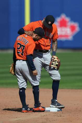 Houston Astros shortstop Carlos Correa (1) talks with second baseman Jose Altuve (27) after the baseball game against the Toronto Blue Jays in Buffalo, N.Y., Sunday, June 6, 2021. (AP Photo/Joshua Bessex) Photo: Joshua Bessex, Associated Press / Copyright 2021 The Associated Press. All rights reserved