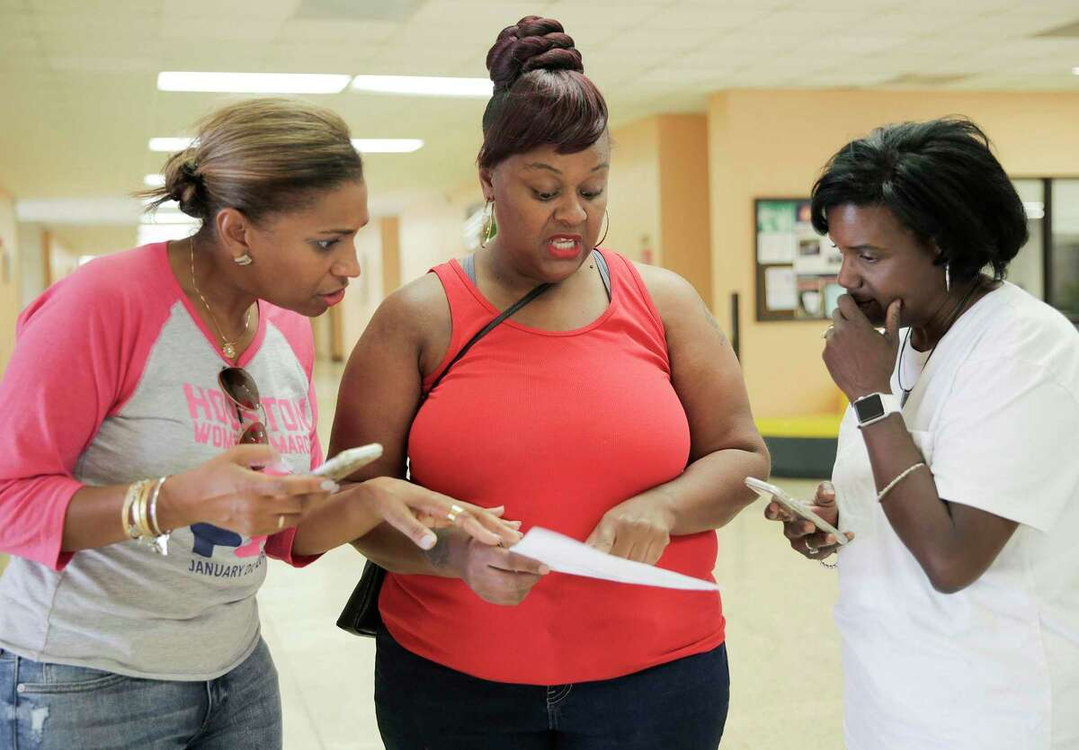 """Voting reform should make it easier for eligible voters to vote, but in the view of the editorial board, too many of the GOP efforts in Texas have been designed to make it harder. Here, Shaila Gullory gets help from Letitia Plummer, right, and Adoneca Fortier on finding polling location in 2018. Gullory had voted before, when she changed her address at the DMV, she filled out the paper work, and said they would turn it in. The paperwork apparently never got sent it, as she was no longer on the voter rolls. """"This is so frustrating,"""" said Gullory."""