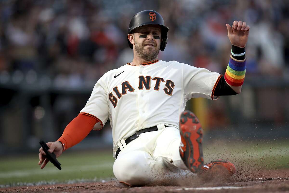 San Francisco Giants' Evan Longoria scores on a Brandon Crawford double during the fifth inning of a baseball game against the Chicago Cubs on Saturday, June 5, 2021, in San Francisco. (AP Photo/Scot Tucker)