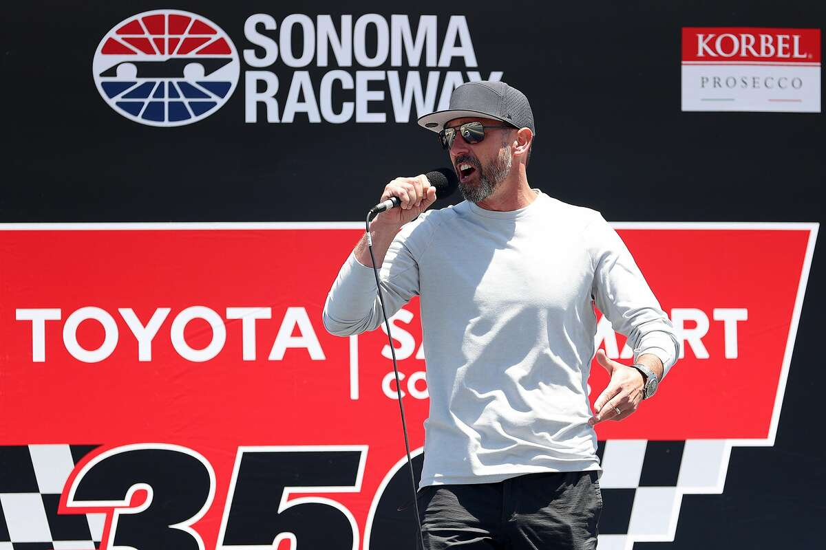San Francisco 49ers head coach Kyle Shanahan gives the command to start engines prior to Sunday's Toyota/Save Mart 350 at Sonoma Raceway.