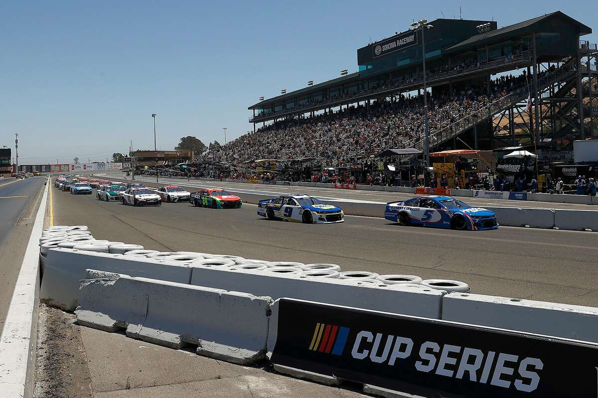 Kyle Larson leads Chase Elliott into turn one during Sunday's Toyota/Save Mart 350 at Sonoma Raceway. The teammates finished the race 1-2.