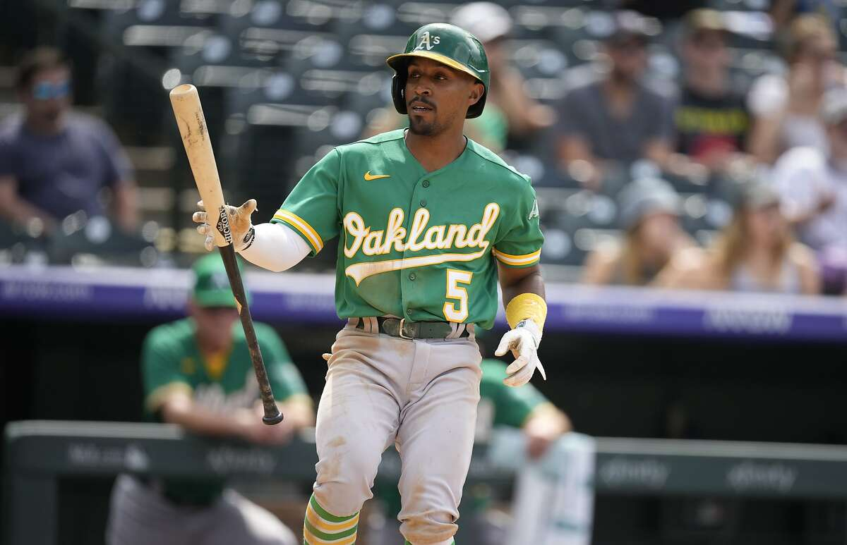 The A's Tony Kemp reacts after striking out against Colorado Rockies relief pitcher Mychal Givens in the seventh inning of a baseball game Sunday, June 6, 2021, in Denver. (AP Photo/David Zalubowski)