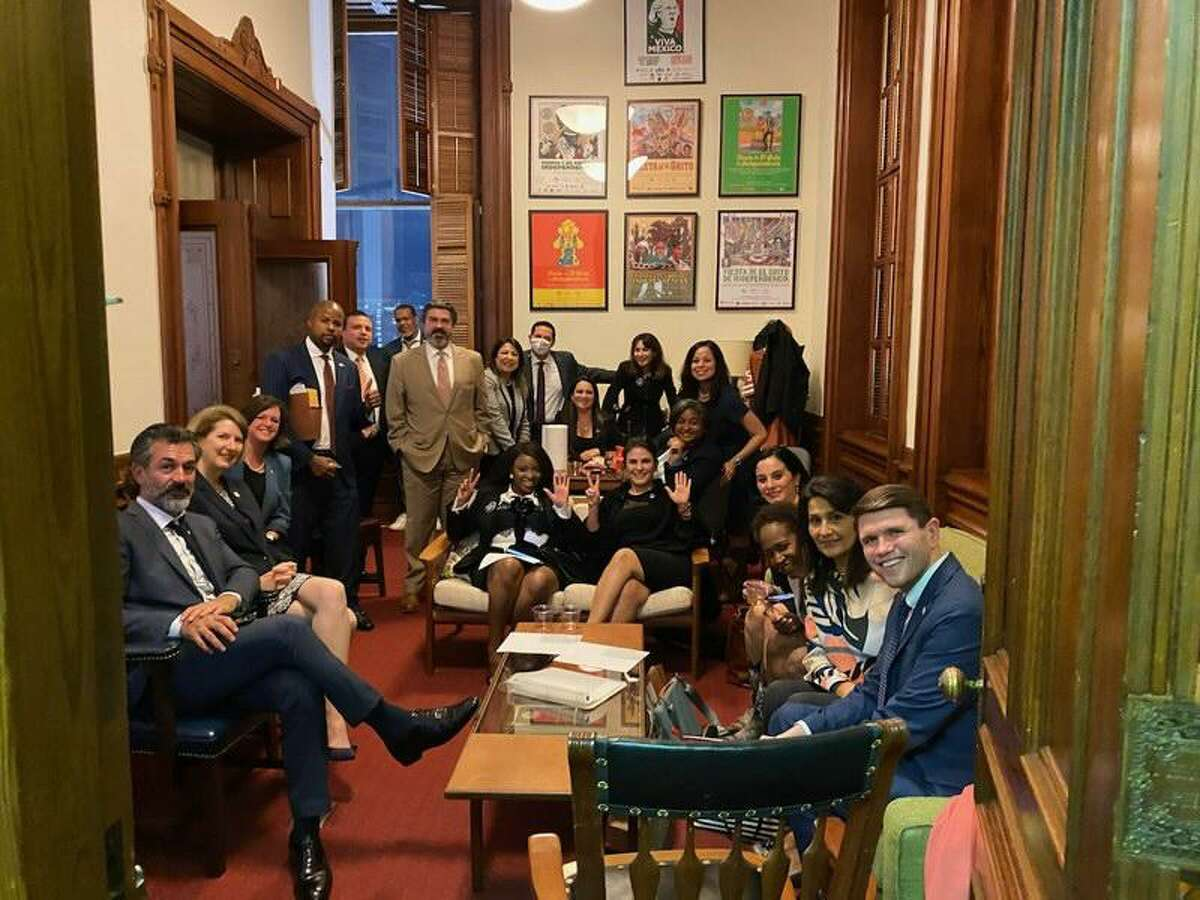 A group of Texas House Democrats huddle in the office of state Rep. Eddie Rodriguez, D-Austin, on Sunday, May 30, 2021.