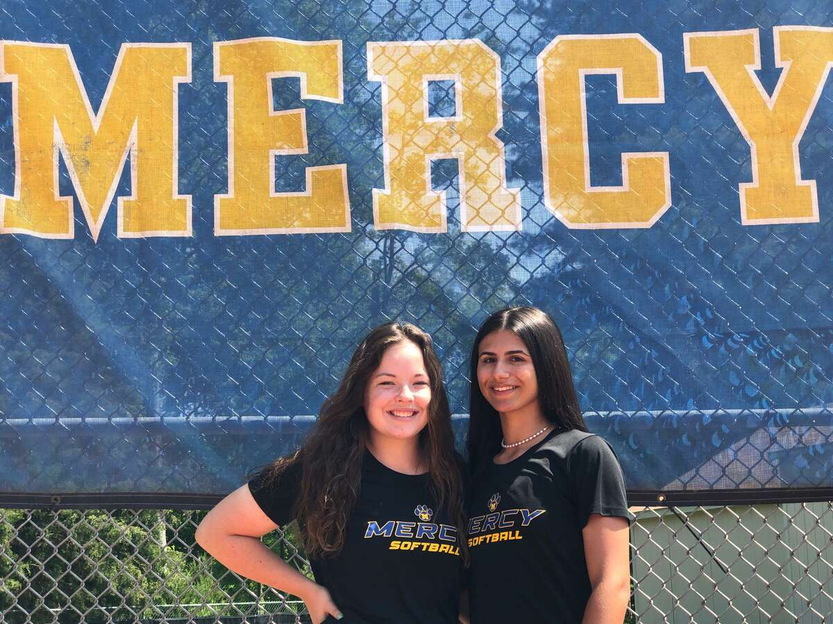 Mercy's Alexa Boone, left, and Ashley DeLuca helped led the Tigers to a 13-win turnaround season.