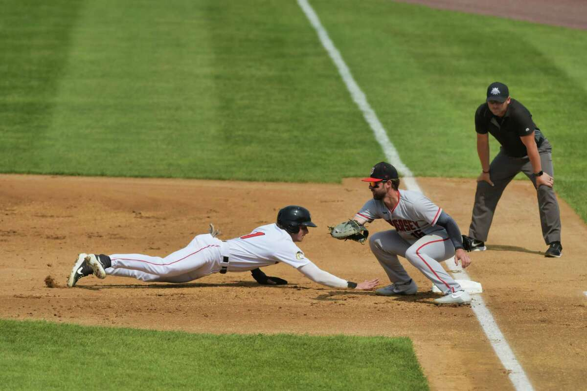 Carson Maxwell, left, of the ValleyCats, slides safely back to first base during their game against New Jersey on Sunday, June 6, 2021, in Troy, N.Y. (Paul Buckowski/Times Union)
