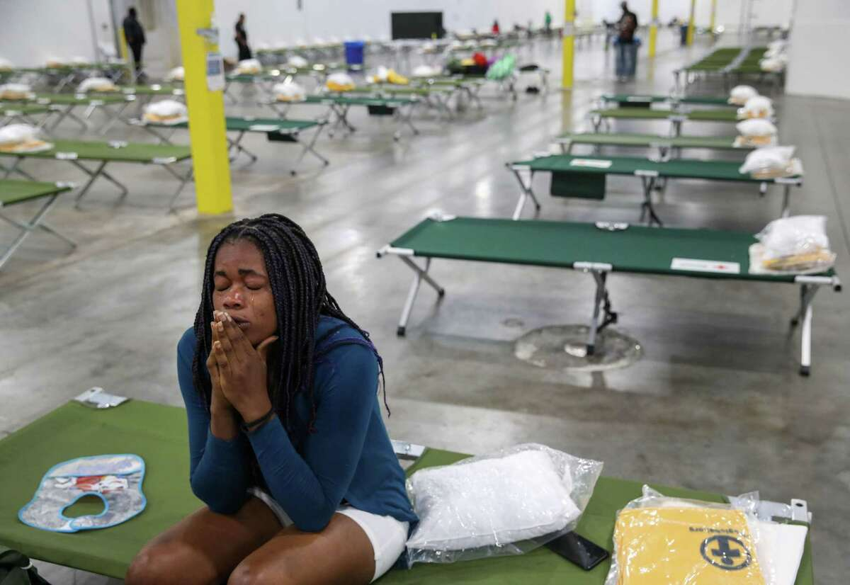 Haitian migrant Jouseline Metayer cries as she talks about how she was separated from her partner after crossing the southern border.