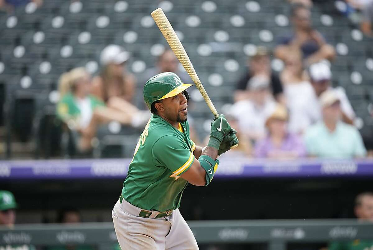 Oakland Athletics' Elvis Andrus follows the flight of his double off Colorado Rockies relief pitcher Mychal Givens in the seventh inning of a baseball game Sunday, June 6, 2021, in Denver. (AP Photo/David Zalubowski)