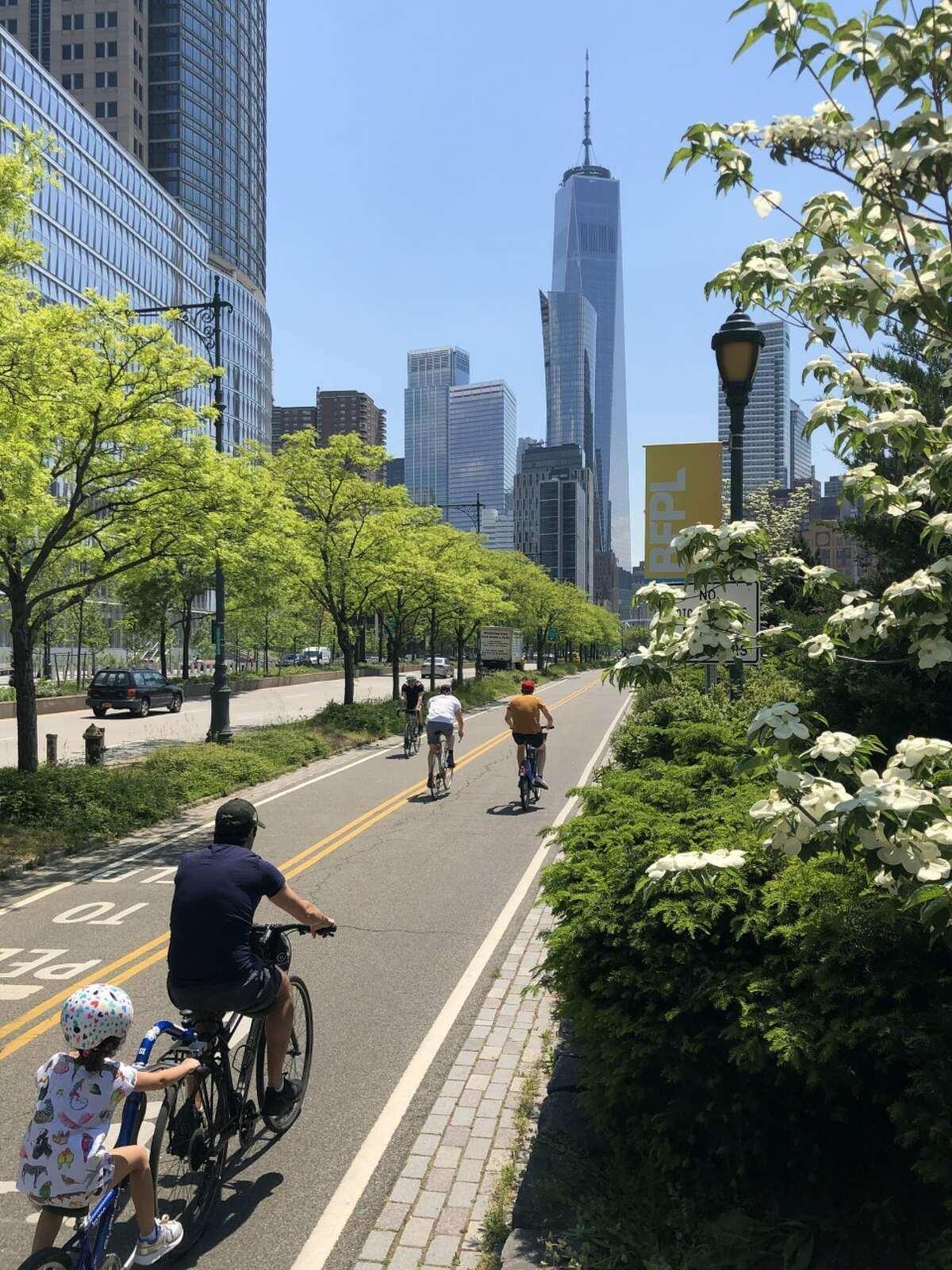 Bicyclists ride south on the Hudson River Greenway toward One World Trade Center (credit: Phil Brown)