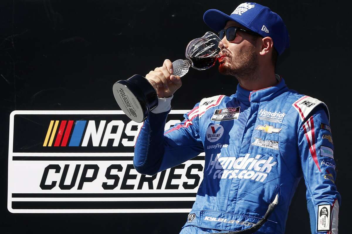 Kyle Larson celebrates his Sonoma victory with some wine, but his attempt to re-create a winning photo went awry.