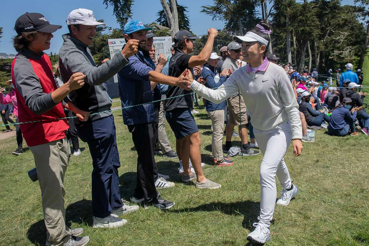 Lucy Li greets cheering spectators after completing the 18th hole during the fourth round of the 76th U.S. Women's Open Championship held on the Lake Course at the Olympic Club, Sunday, June 6, 2021, in San Francisco, Calif.