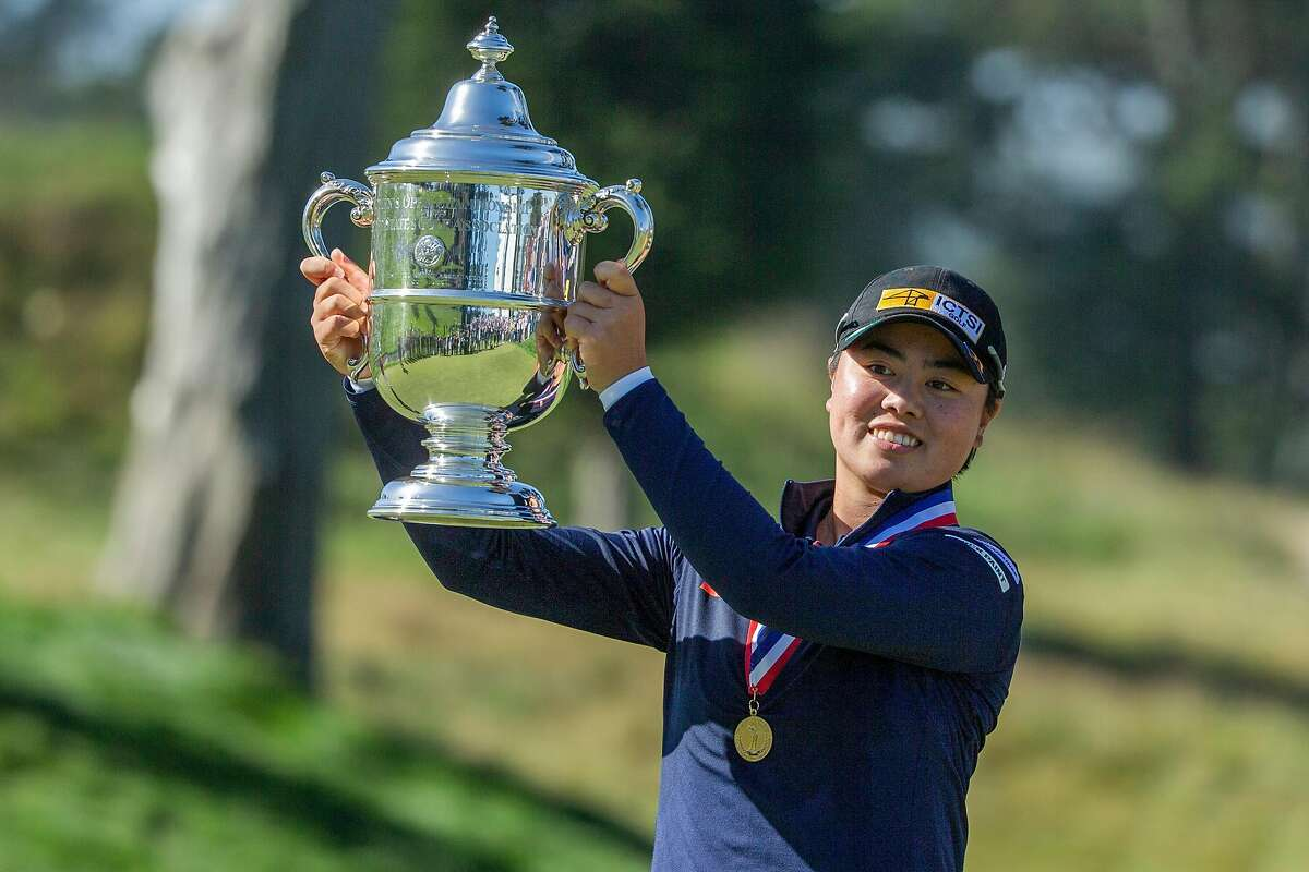 Yuka Saso of the Philippines celebrates with the Harton S. Semple Trophy after winning the 76th U.S. Women's Open Championship held on the Lake Course at the Olympic Club, Sunday, June 6, 2021, in San Francisco, Calif. Saso won following a three-hole playoff against Nasa Hataoka of Japan.