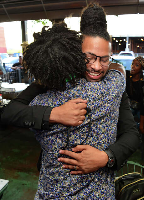 Jalen McKee-Rodriguez is hugged by supporters during a post-election event at Tuckers Kozy Korner Satuerday night. McKee-Rodriguez won District 2 by a wide margin, capturing 63 percent of the vote, and is the first openly gay man elected in San Antonio, and the first openly gay Black man elected in the state of Texas, according to LGBTQ Victory Fund. Photo: Robin Jerstad / Contributor / **MANDATORY CREDIT FOR PHOTOG AND SAN ANTONIO EXPRESS-NEWS/NO SALES/MAGS OUT/TV