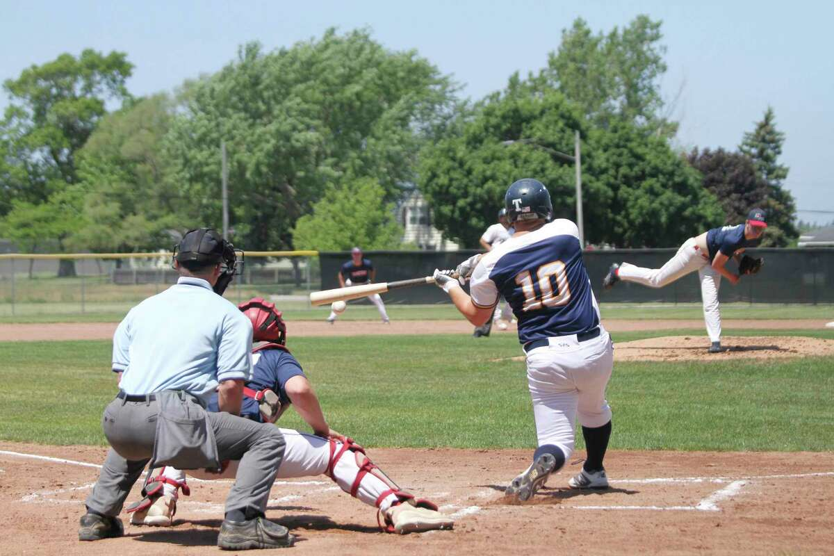 Lucas Richardson makes contact during the Manistee Saints' home opening victories on Sunday at Rietz Park. (Dylan Savela/News Advocate)
