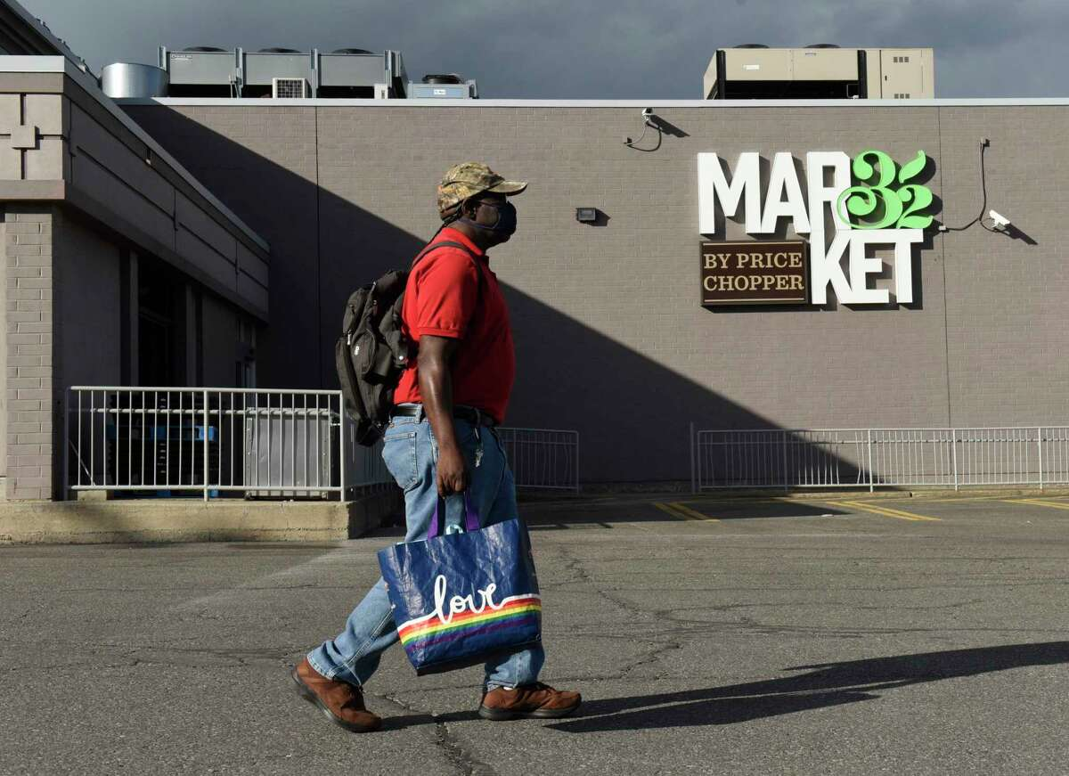 Tim Simmons walks home with his groceries after shopping at the Price Chopper on Delaware Avenue on Wednesday, May 12, 2021 in Albany, N.Y. (Lori Van Buren/Times Union)