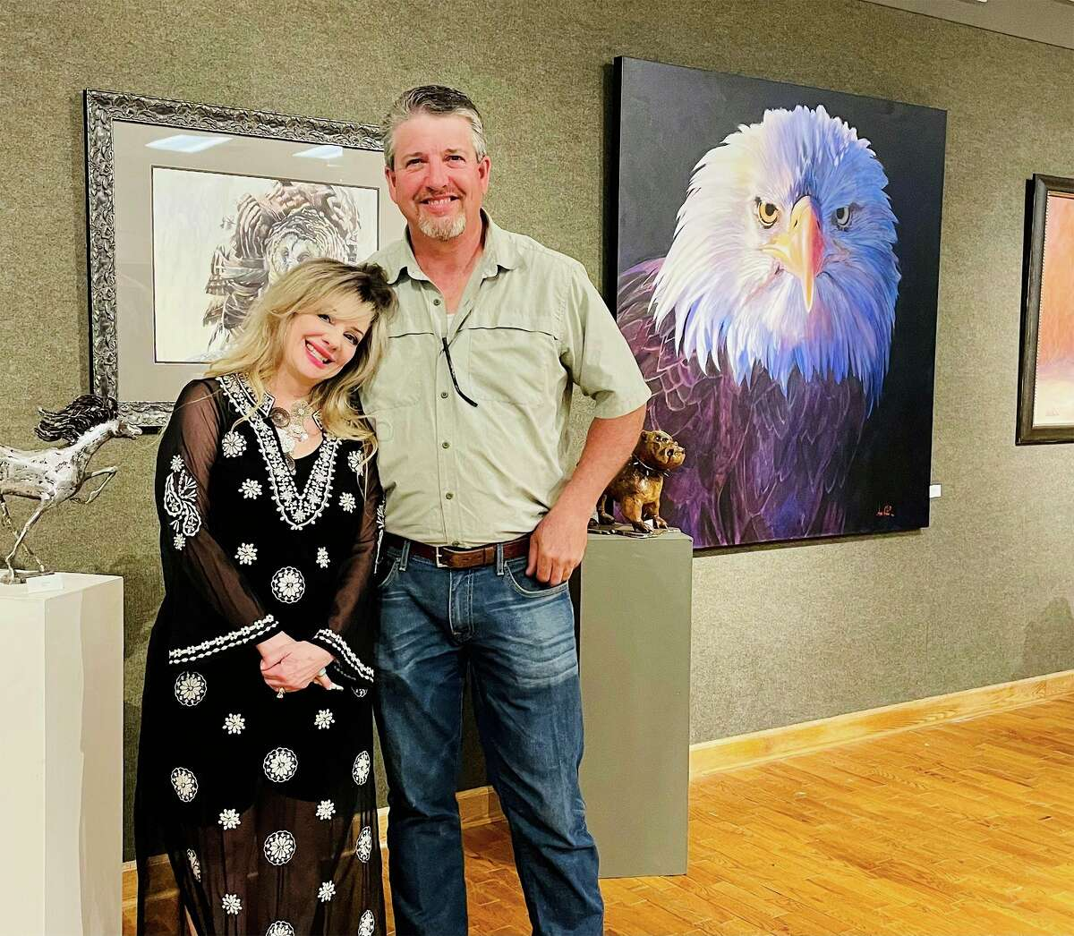 Watercolor artist Anni Crouter and barbed wire sculptor Jeff Best pose Thursday as part of the opening reception for their Wild Things exhibit at Artworks. The exhibit runs through July 1. (Courtesy/Artworks)