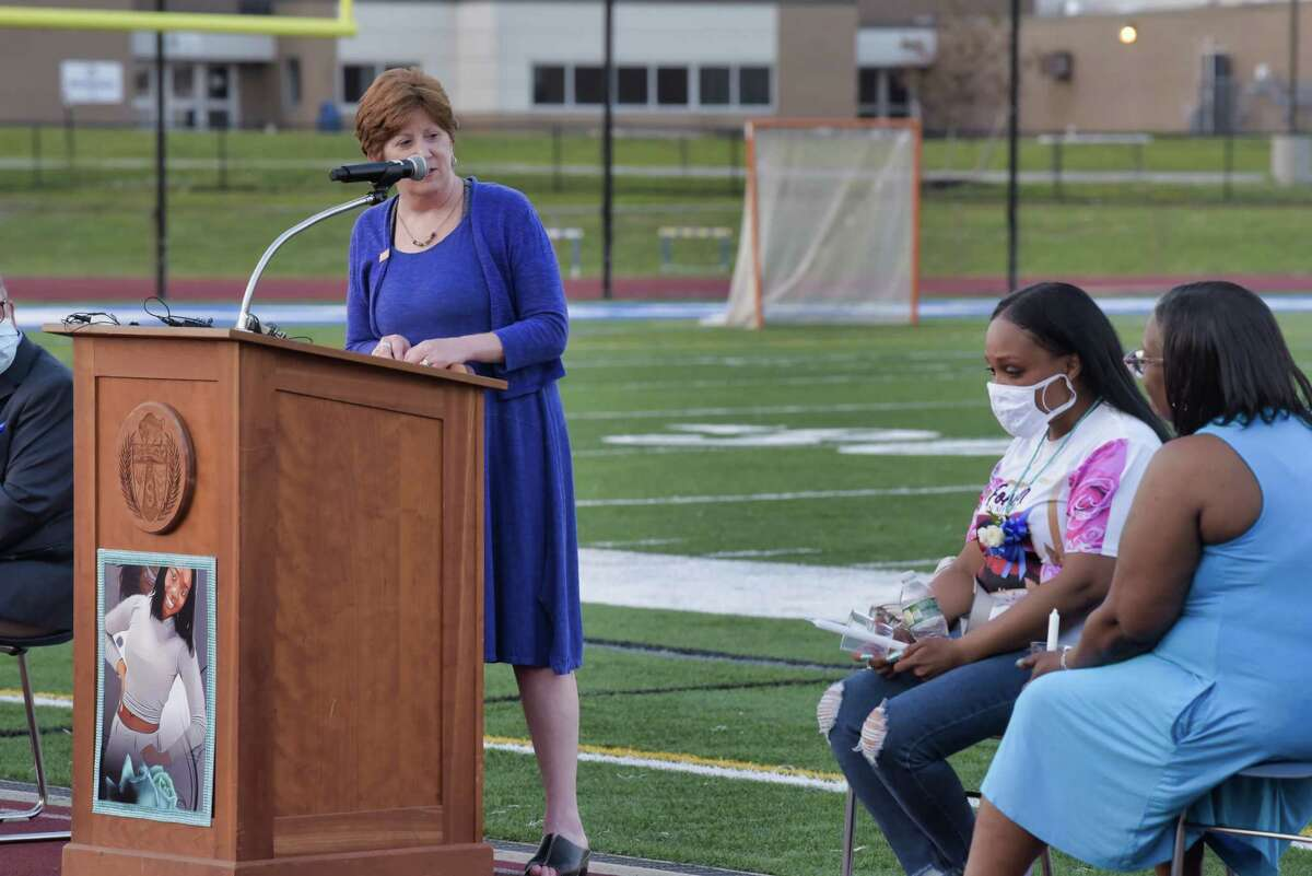 Albany Mayor Kathy Sheehan, left, speaks at a vigil held for Destiny Greene, as Destiny's mother, Tareen Lynch-Greene, second from right, listens, on Sunday, June 6, 2021, at Shaker High School in Latham, N.Y. (Paul Buckowski/Times Union)