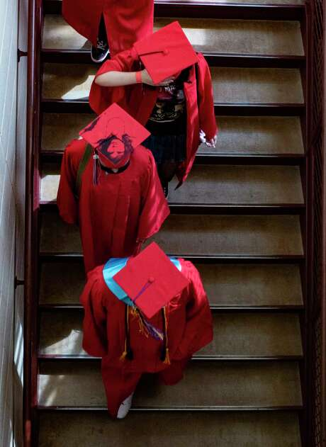 Graduating seniors of Southside High School parade through the halls of Losoya Middle School on Tuesday, June 1. Photo: Billy Calzada / Staff Photographer / `
