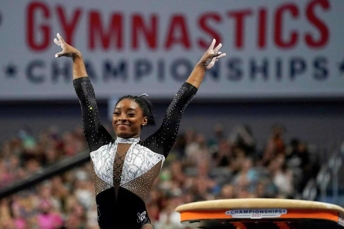 Simone Biles had a winning score of 119.65, including 60.1 points Sunday, in taking her seventh all-around U.S. gymnatics title at Dickies Arena in Fort Worth.