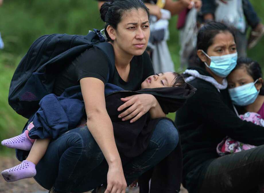 A migrant mother plays with her child after U.S. Border Patrol agents detained around 200 migrants, mostly families, along Military Road in La Joya, Texas on June 3. The number of undocumented immigrants caught at the U.S-Mexico border continues to rise. Photo: Jerry Lara / Staff Photographer / **MANDATORY CREDIT FOR PHOTOG AND SAN ANTONIO EXPRESS-NEWS/NO SALES/MAGS OUT/TV   © 2019 San Antonio Express-News