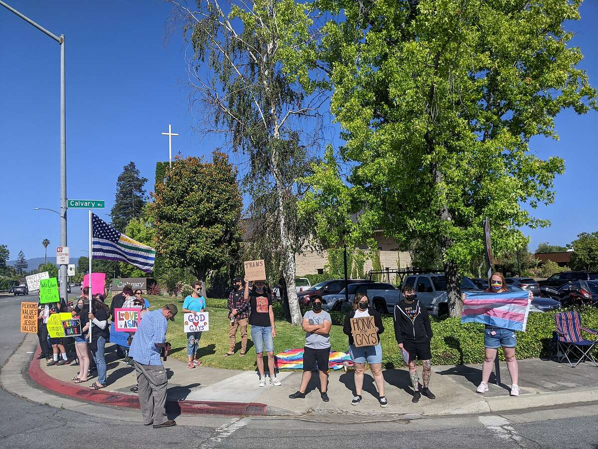 A group protests outside San Jose's Calvary Chapel in response to the church hosting Family Research Council leader Tony Perkins.