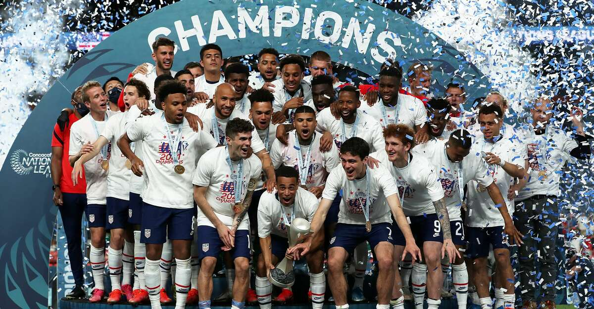 Players of United States lift the trophy after wining the CONCACAF Nations League Championship Final between United States and Mexico at Empower Field At Mile High on June 6, 2021 in Denver, Colorado. (Photo by Omar Vega/Getty Images)